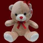 Comprar urso de pelúcia com laço vermelho